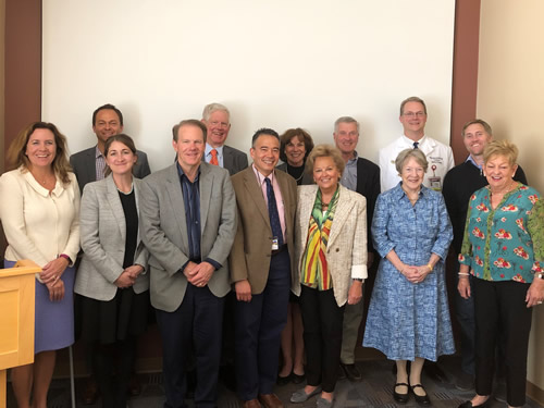 Dr. Richard Schulick (front row center),staff and members of the Cancer Center Roundtable