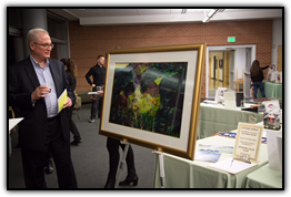 Former Littleton mayor Phil Cernanec viewing Eyvind Earle artwork