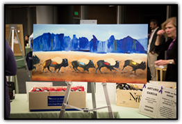 Painting by pancreatic cancer survivor Arturo Garcia on display in the silent auction